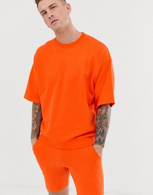 FOS DESIGN tracksuit short sleeve sweatshirt/skinny shorts in bright orange