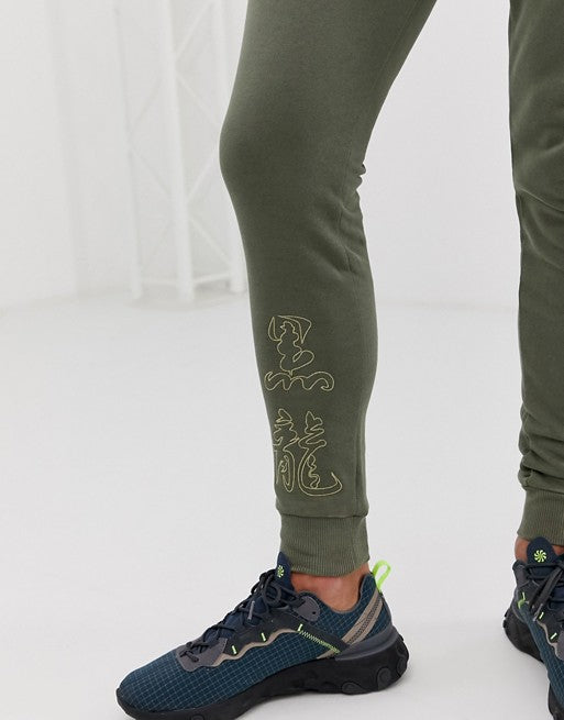 FOS DESIGN skinny joggers with embroidered symbols