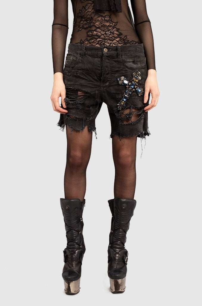 A close-up of a black distressed denim shorts for women collection by Faith Connexion, a brand of luxury clothes