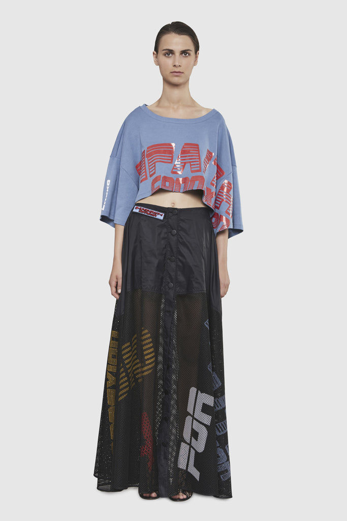 A woman is wearing a Shuko printed long skirt by Faith Connexion, a brand of luxury clothes