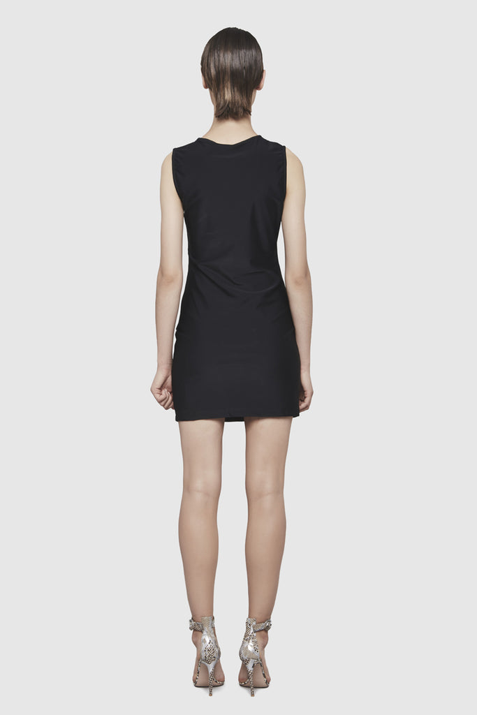 A woman is wearing a Shuko black sleeveless dress by Faith Connexion, a brand of luxury clothes