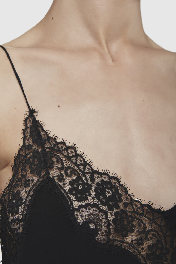 A close-up of a black silky nightgown dress by Faith Connexion, a brand of luxury clothes