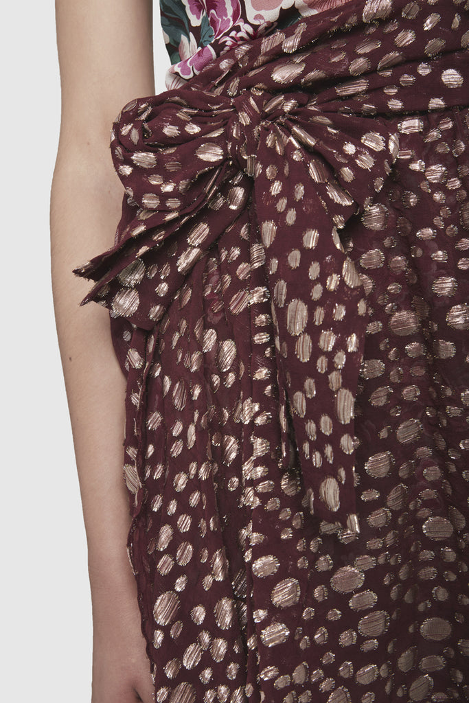 A close-up of a one shoulder dress with floral print by Faith Connexion, a brand of luxury clothes