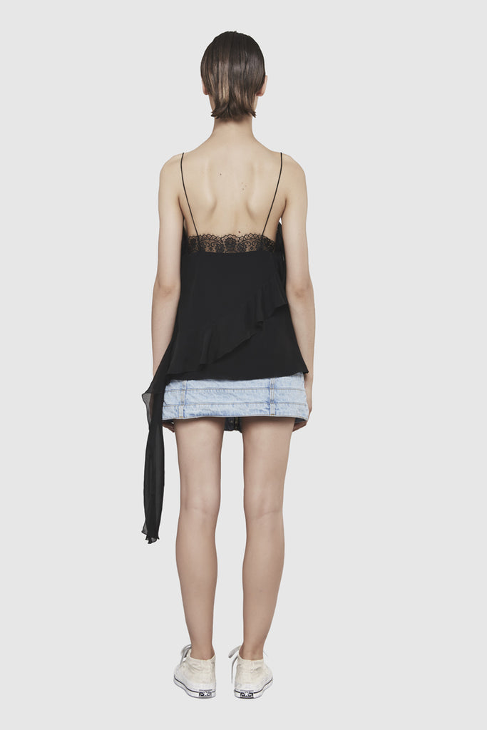 Full length back picture. A woman is wearing a black lingerie top by Faith Connexion, a brand of luxury clothes