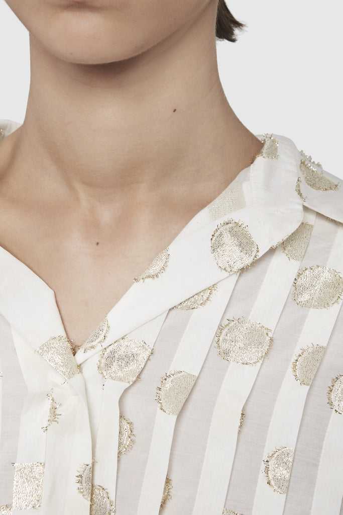 A close-up of an asymmetric plastron oversize shirt by Faith Connexion, a brand of luxury clothes