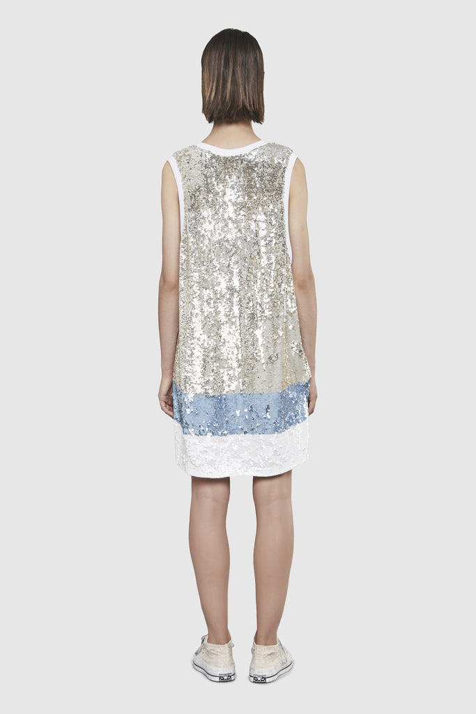 A woman is wearing a sequins long tank top by Faith Connexion, a brand of luxury clothes