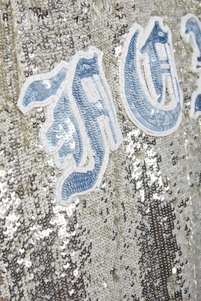 A close-up of a sequins long tank top by Faith Connexion, a brand of luxury clothes