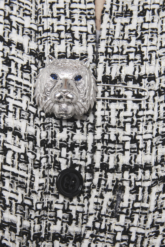 A close-up of a black and white checked tweed shirt by Faith Connexion, a brand of luxury clothes