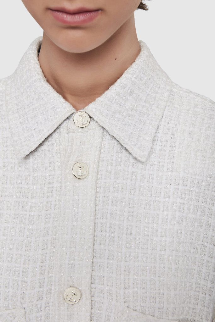 A close-up of a white tweed shirt by Faith Connexion, a brand of luxury clothes