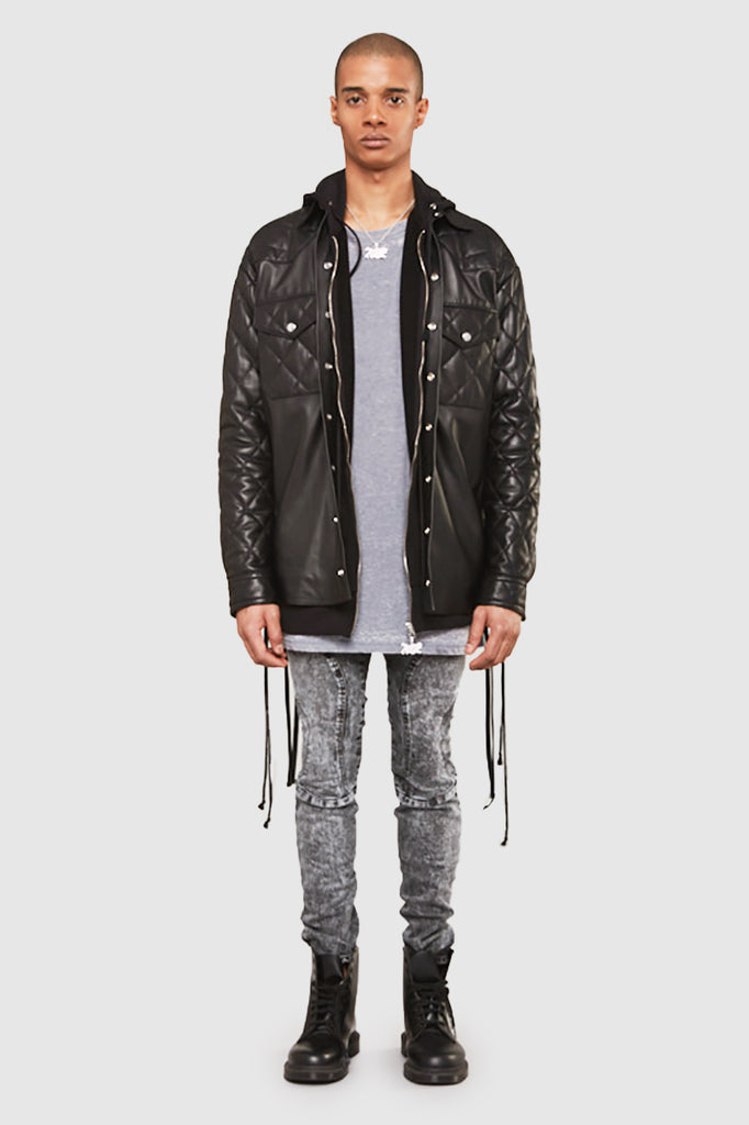A man is wearing a leather fringe jacket by Faith Connexion, a brand of luxury clothes