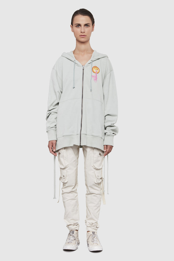 A woman is wearing a Todd James zipped hoodie by Faith Connexion, a brand of luxury clothes