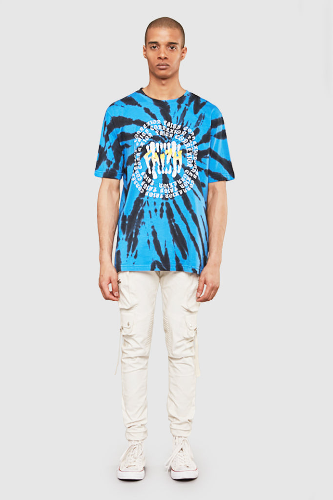 A man is wearing a tie and dye print t-shirt by Faith Connexion, a brand of luxury clothes