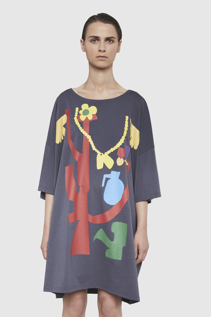A woman is wearing a Todd James printed dress t-shirt by Faith Connexion, a brand of luxury clothes