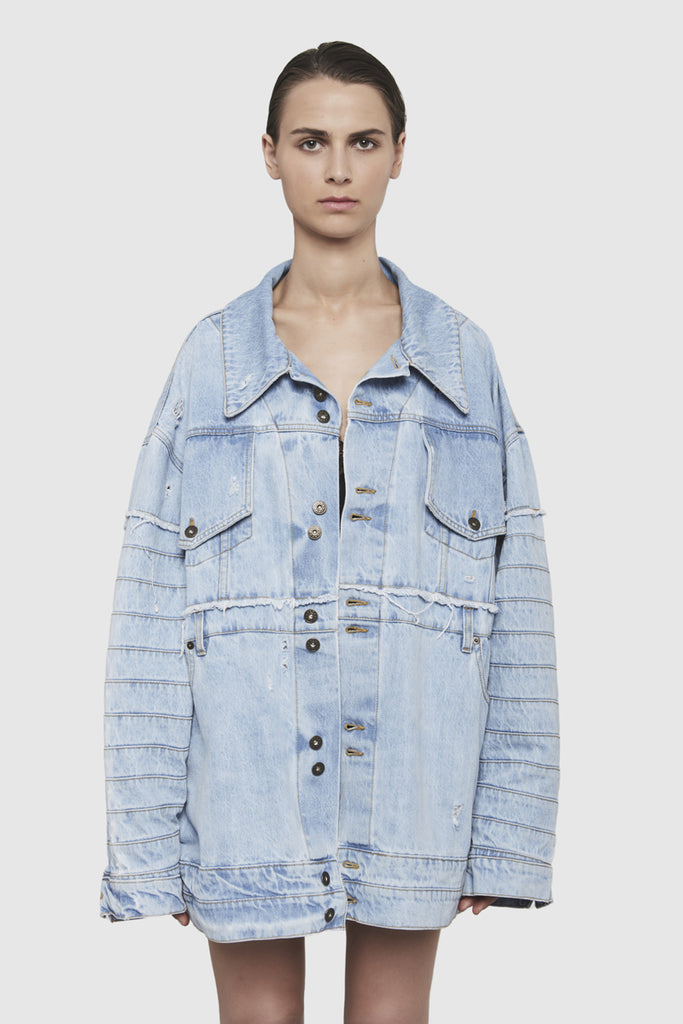 A women is wearing a reconstructed denim jacket by Faith Connexion, a brand of luxury clothes