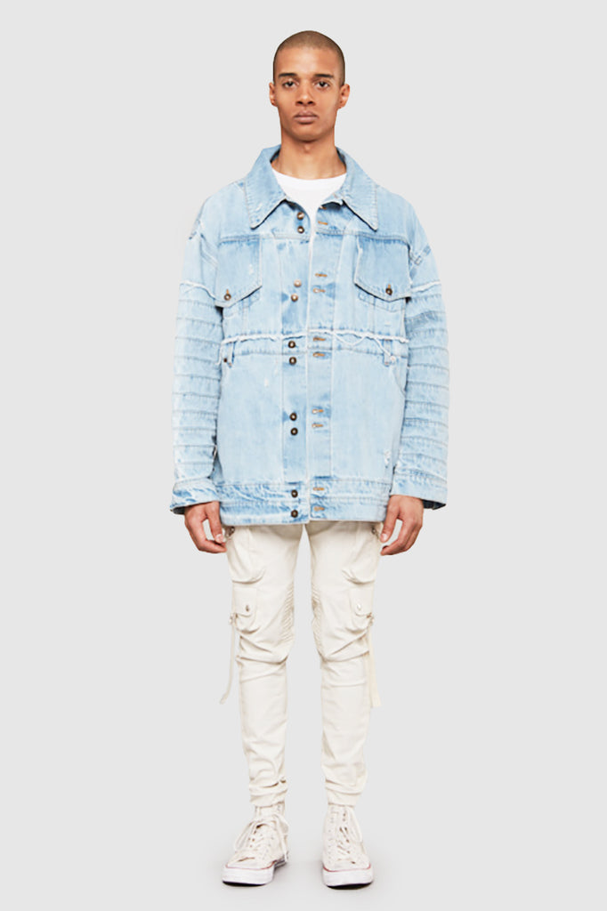 A man is wearing a reconstructed denim jacket by Faith Connexion, a brand of luxury clothes