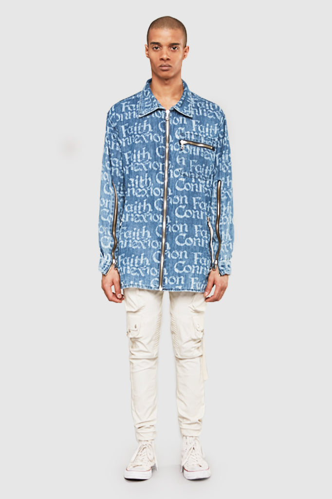 A man is wearing an NTMB all-over print denim shirt by Faith Connexion, a brand of luxury clothes