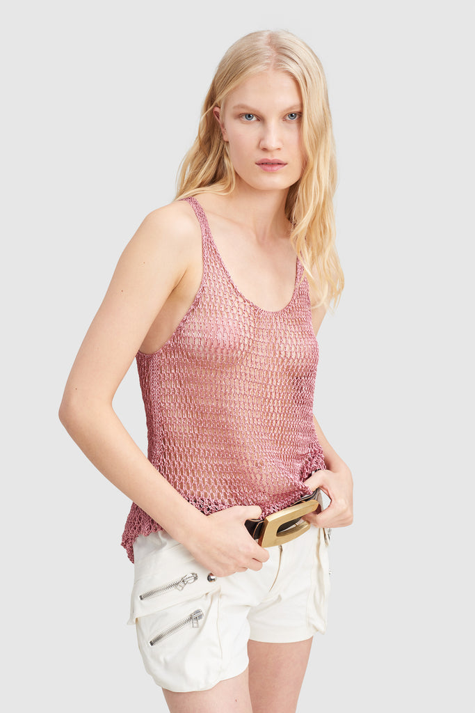A woman is wearing a metal knit tank top by Faith Connexion, a brand of luxury clothes