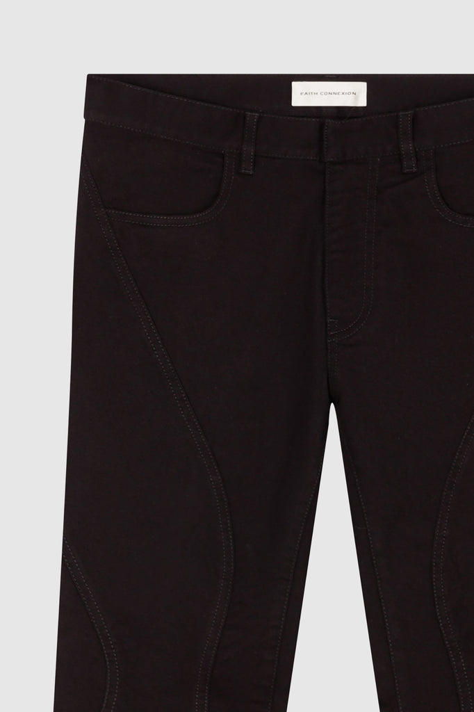 A close-up of black slim jeans for women collection by Faith Connexion, a brand of luxury clothes