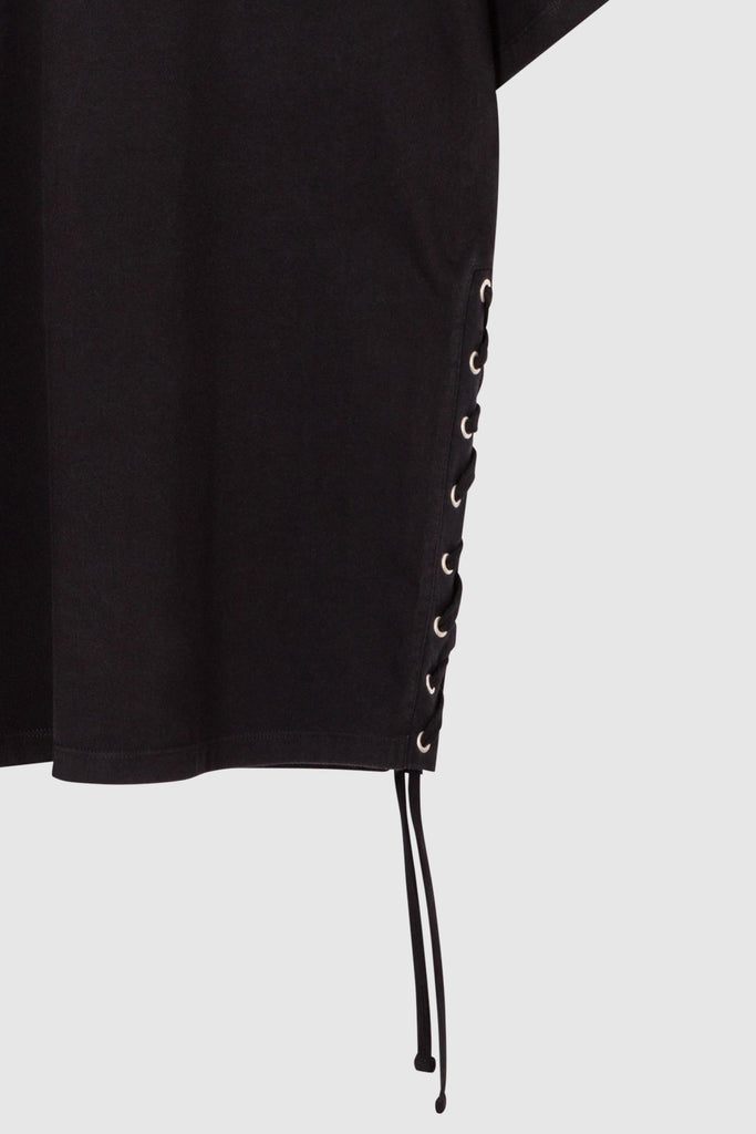 A close-up of a black oversized cotton shirt jacket with lacing details for men collection by Faith Connexion, a brand of luxury clothes