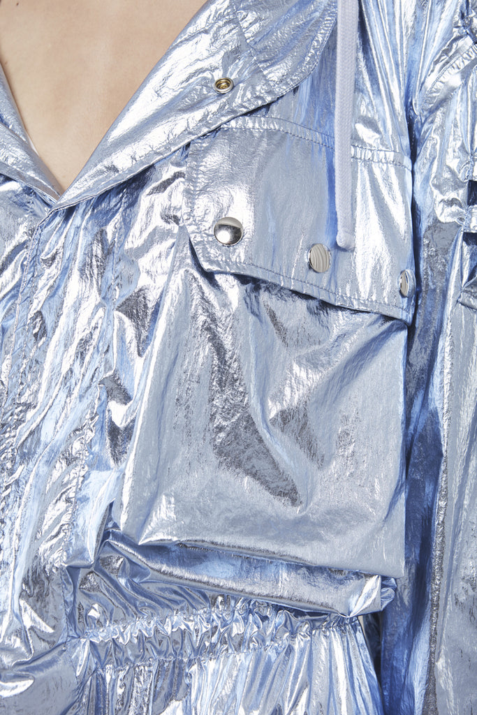 A close-up of a blue metal parka by Faith Connexion, a brand of luxury clothes