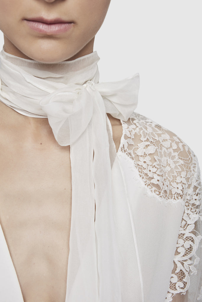A close-up of a white lace laval top by Faith Connexion, a brand of luxury clothes