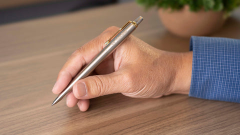 Man writing with Parker Jotter