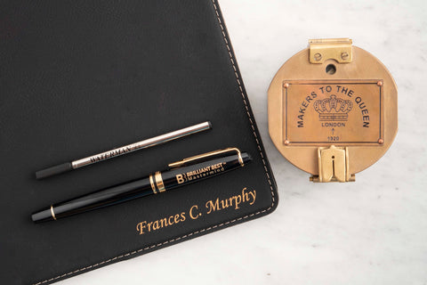 Waterman Expert Fountain Pen with logo engraving and ink refill resting on Dayspring Pens padfolio next to engraved gifts ink well