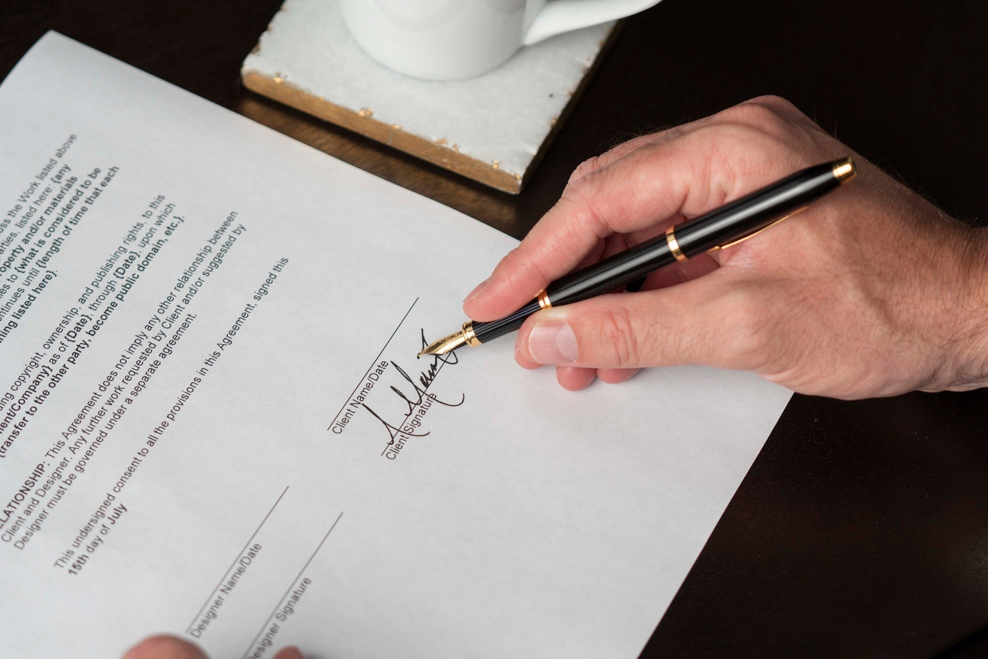 Man signing document with a Cross Century II fountain pen