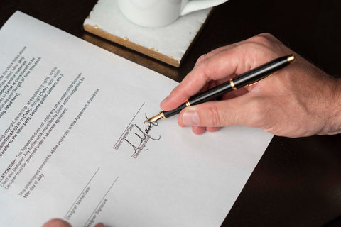 Man signs documents with Cross Pens Century II Fountain Pen
