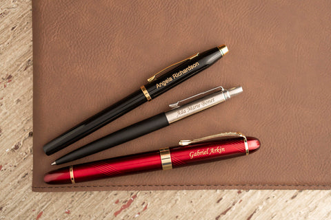 three pens with different engraving fonts