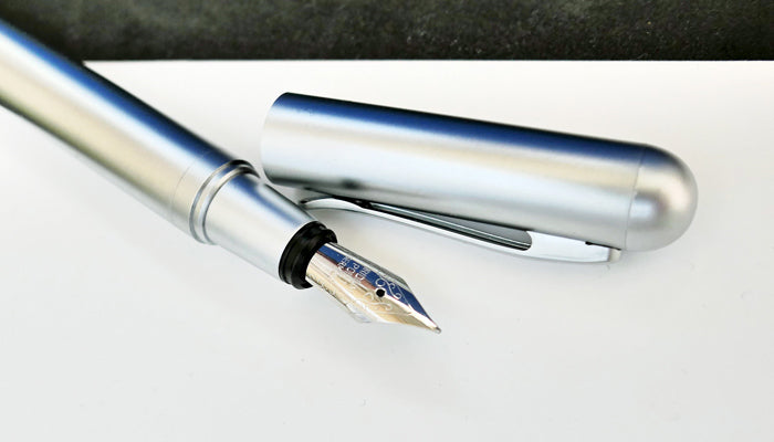 fountain pen with white paper