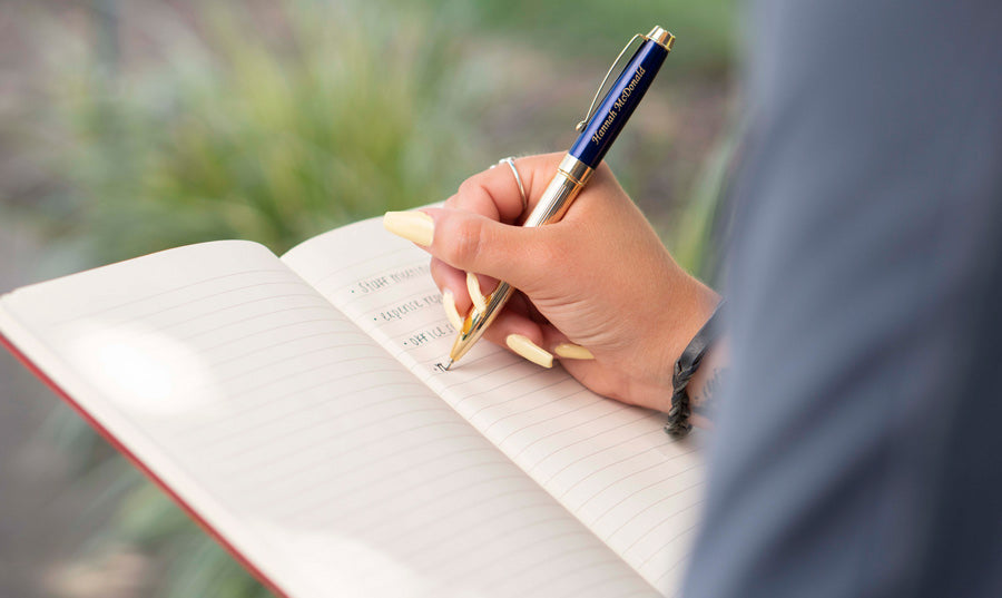 Person writing using personalize pen