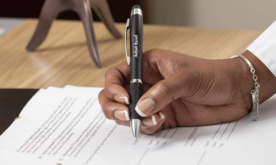 Person using Lumen light up pen while writing