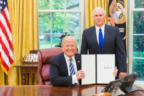 Trump and Pence with signed bill