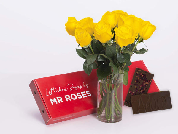 yellow roses with a box of chocolate