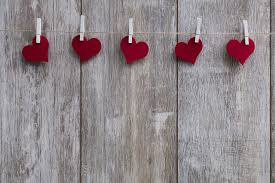 heart shaped paper cut outs hung on a wall