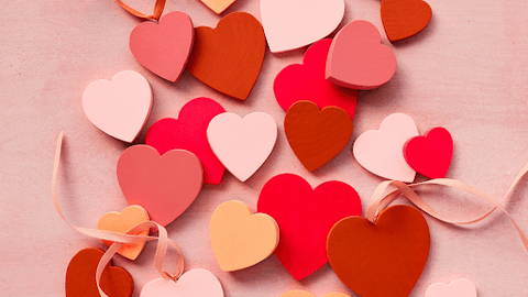 paper cut hearts in different shades of red and pink