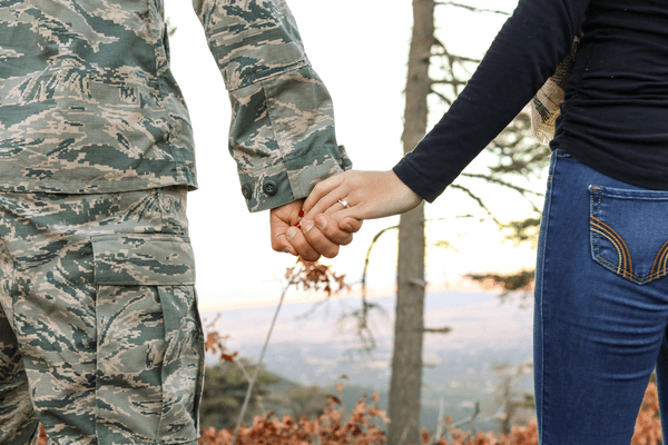 soldier and his wife holding hands