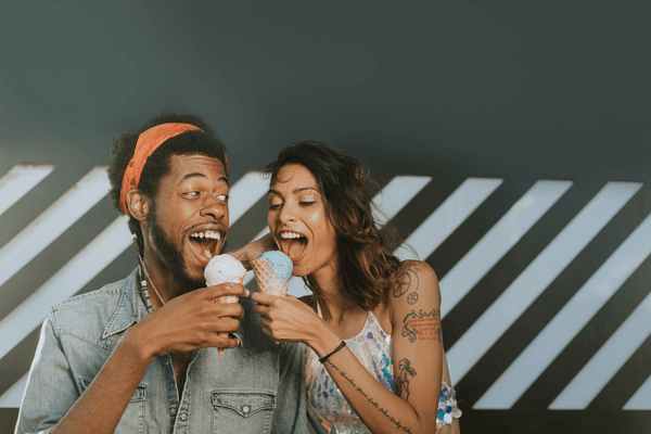 boy and girl having ice cones together