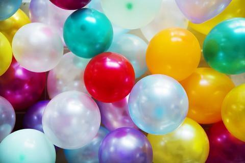 shiny metallic balloons in yellow teal red and silver colours