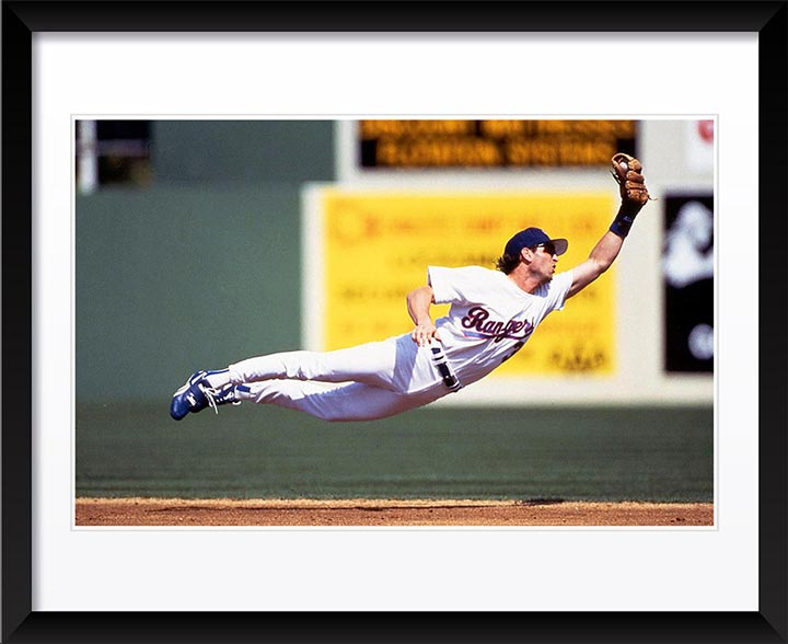 """Player in Mid Air"" by Chuck Solomon Photography"