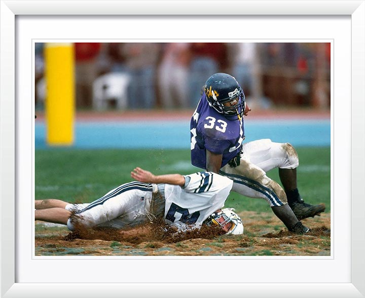 """Football in the Mud"" by Chuck Solomon Photography"