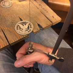 Stuart Richards Cutting a coin with a jewelers saw