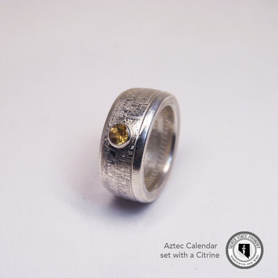 Citrine set into a silver bullion Aztec calendar coin ring