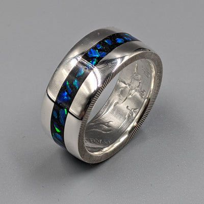 azure blue opal flashing blue and green in a cremation ash coin ring