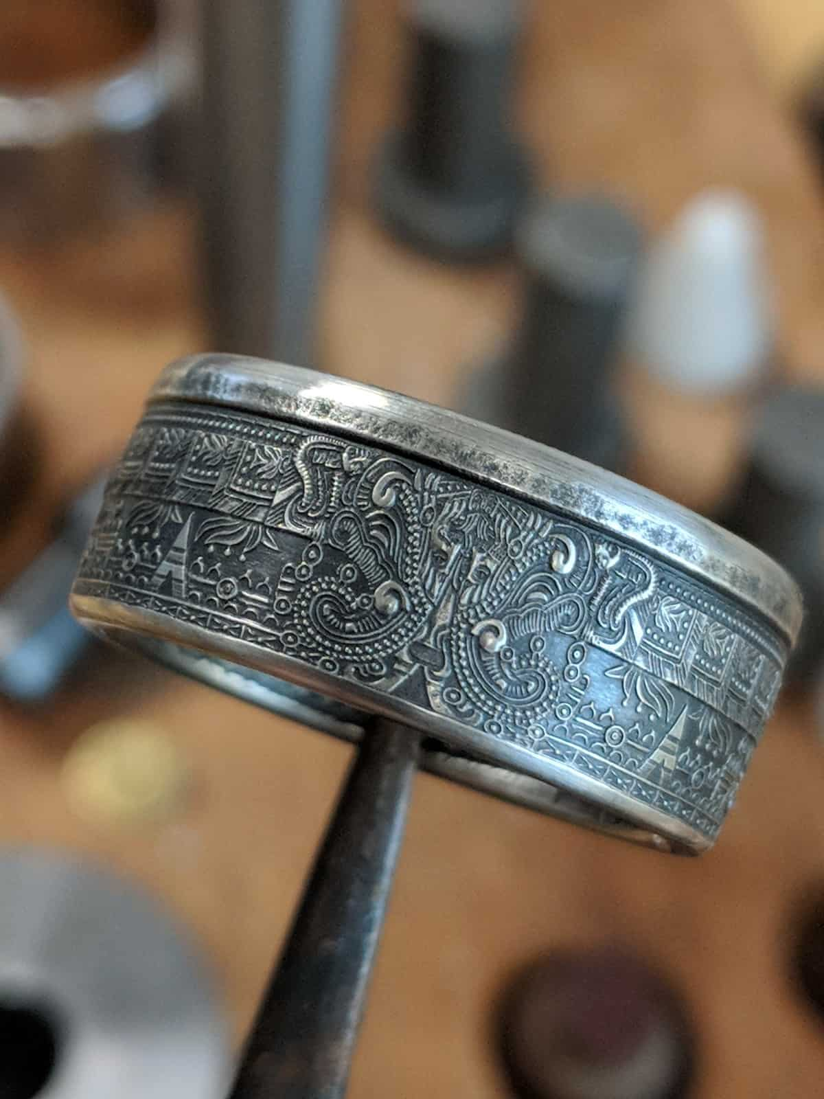 Aztec calendar coin ring with rich patina