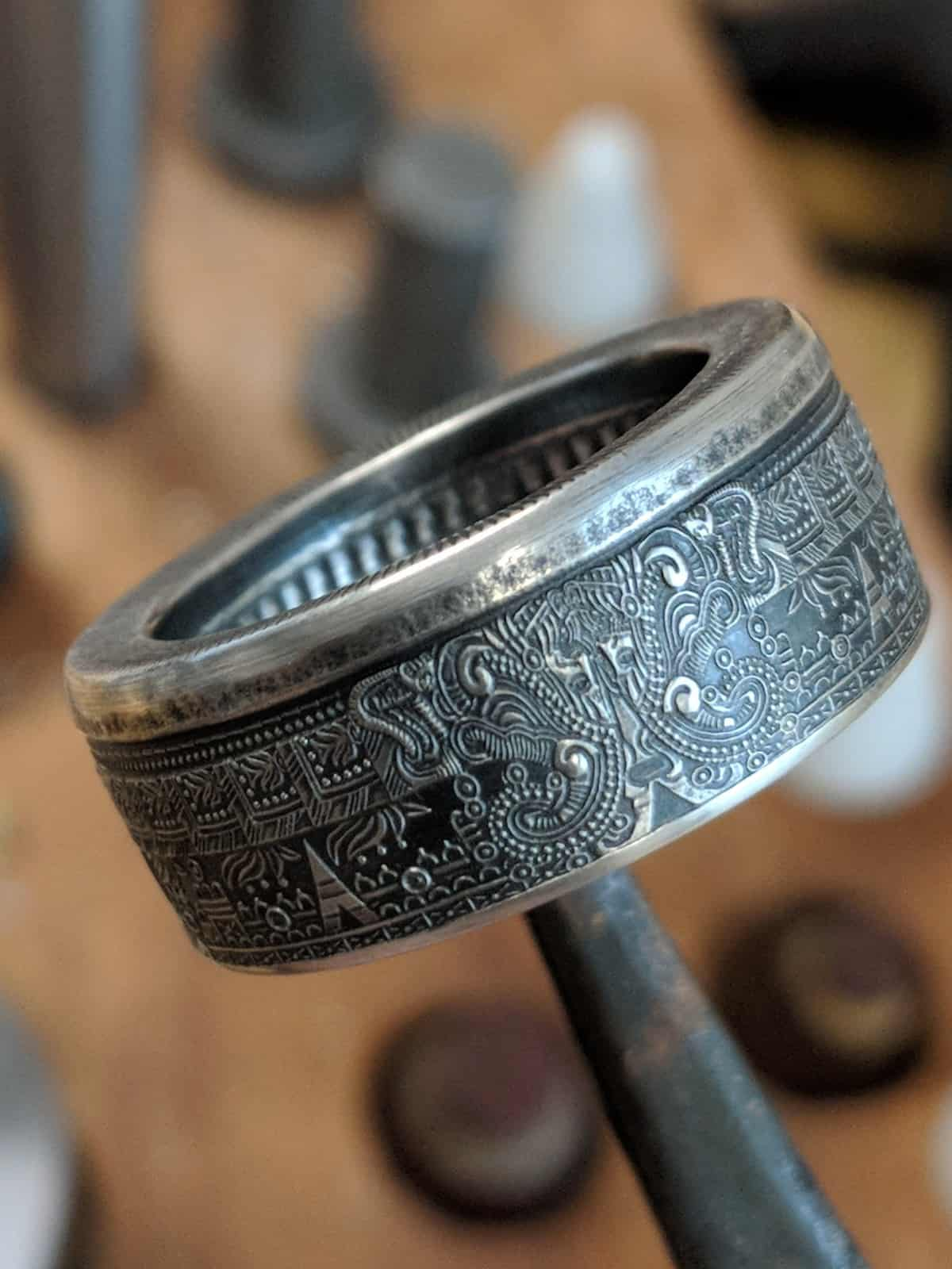 .999 silver Aztec Coin Ring with patina finish.