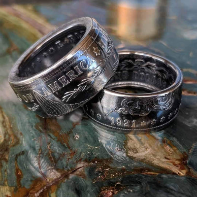 A pair of Morgan Silver Dollar coin rings with a deep patina finish