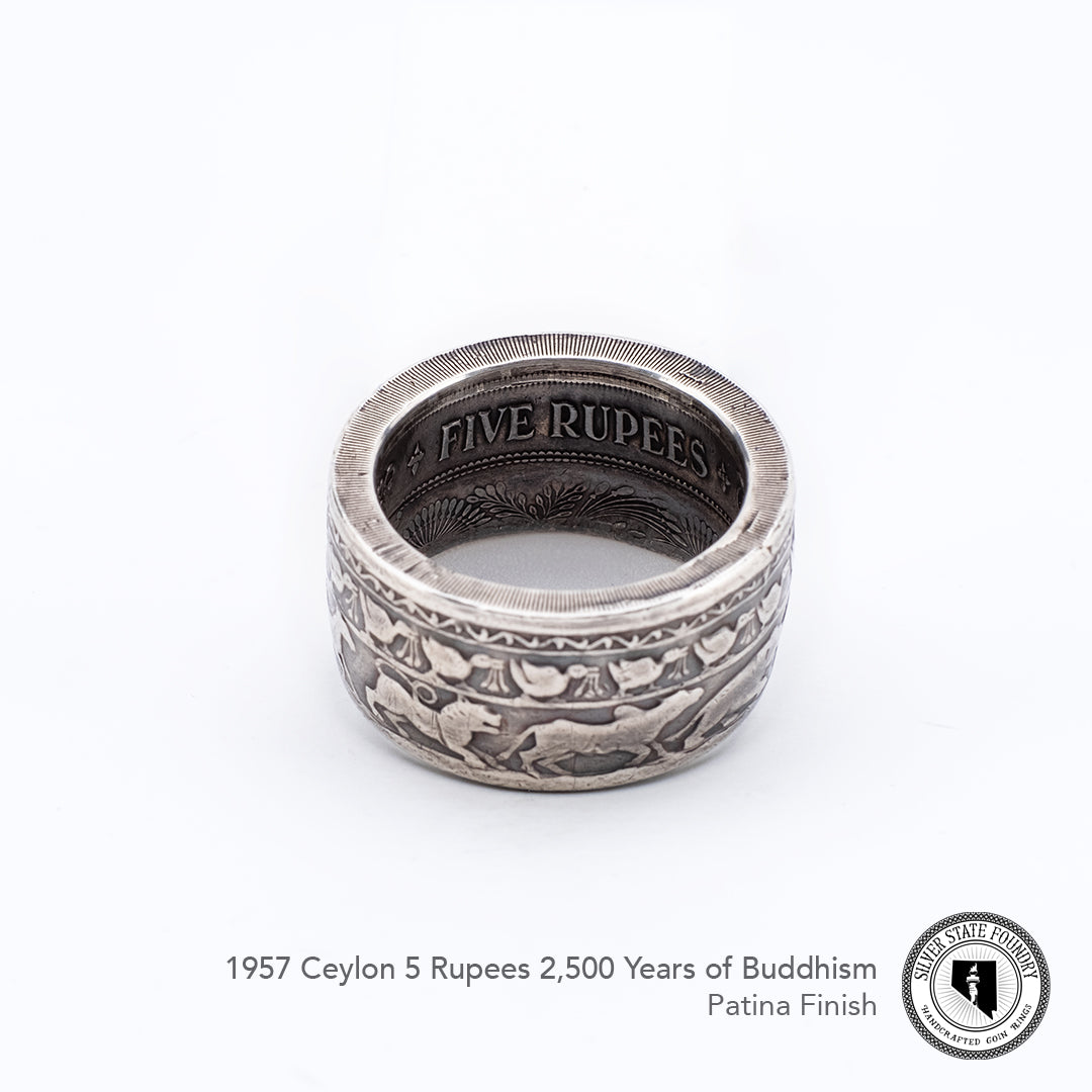 Reeds intact on this buddhism celebration coin ring.