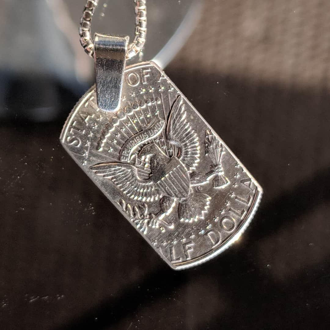 show your pride with a JFK silver dog tag
